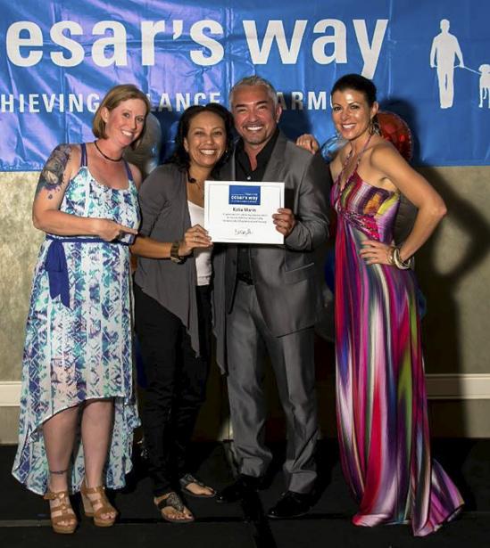 Kathy Presented Certificate by Caesar Milan